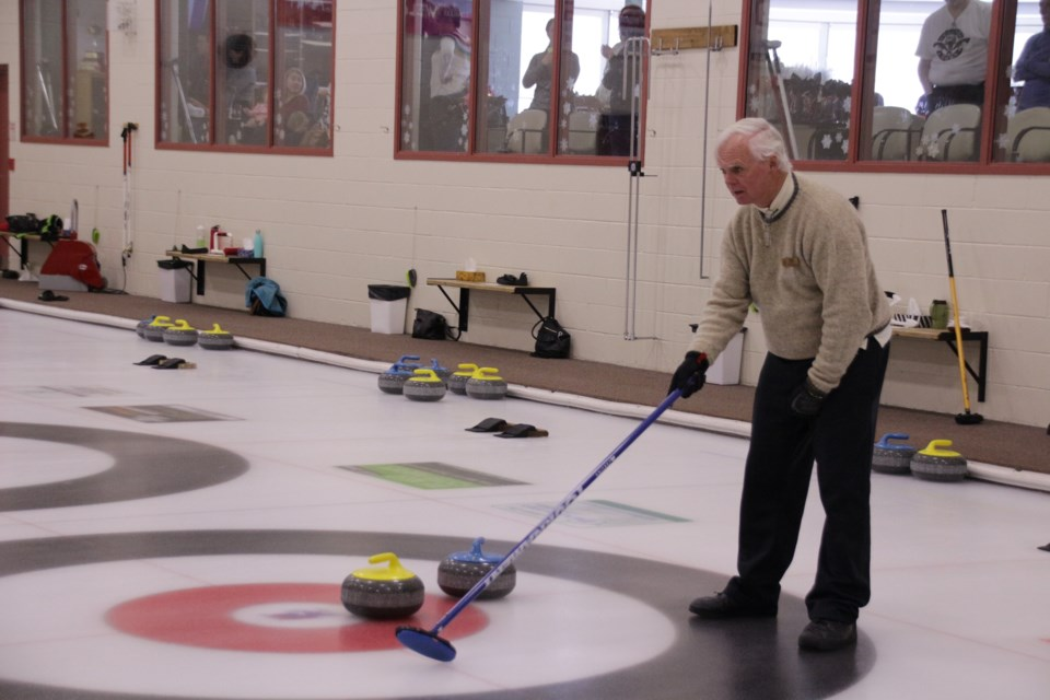 Bob White, of the Orillia Curling Club, waits for his partner to throw the stone from the other end. Mehreen Shahid/OrilliaMatters