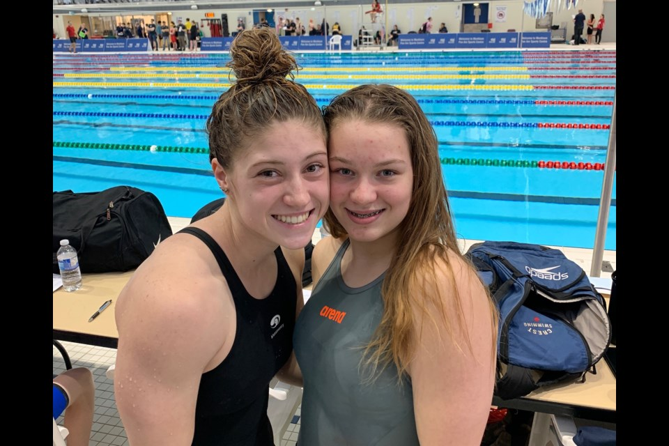 Chloe Smith and Ariel McGee shone at a provincial competition in Markham. Photo provided by the Orillia Channel Cats Swim Club