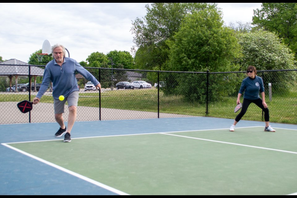 Sharon and Rob Street of Street's Flower Shop use the game of pickleball as a 'stress release' during the COVID-19 pandemic.