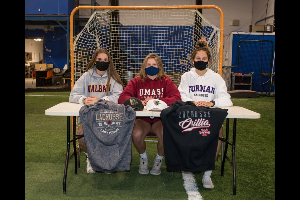 From left: Orillia Lady Kings Emma Torkoff, Kassidy Morris, and Ryan Bionda have agreed to play at Division I lacrosse schools in the United States. Tyler Evans/OrilliaMatters.