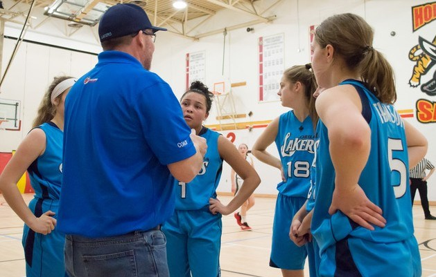 The coach rallies the troops at the Gold Medal Tournament in London. The Lakers' junior girls won a silver medal. Corey Bechthold-Coon photo