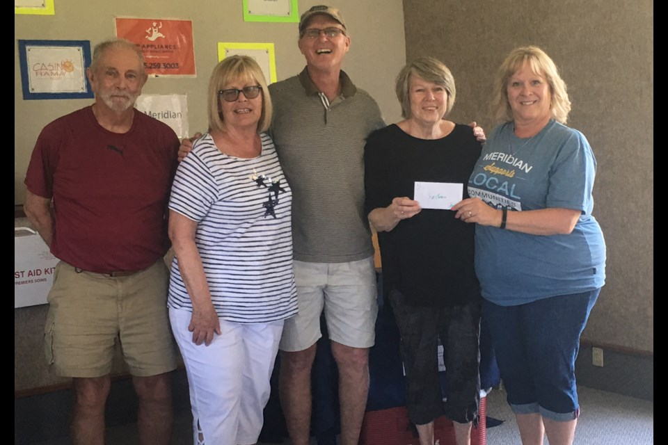 Drawmaster Rick Stinson with the winning team. From left: Lynn Stenson, Mike Kimber and skip Sue O'Neill, being presented their winnings by Meridian representative. Contributed photo
