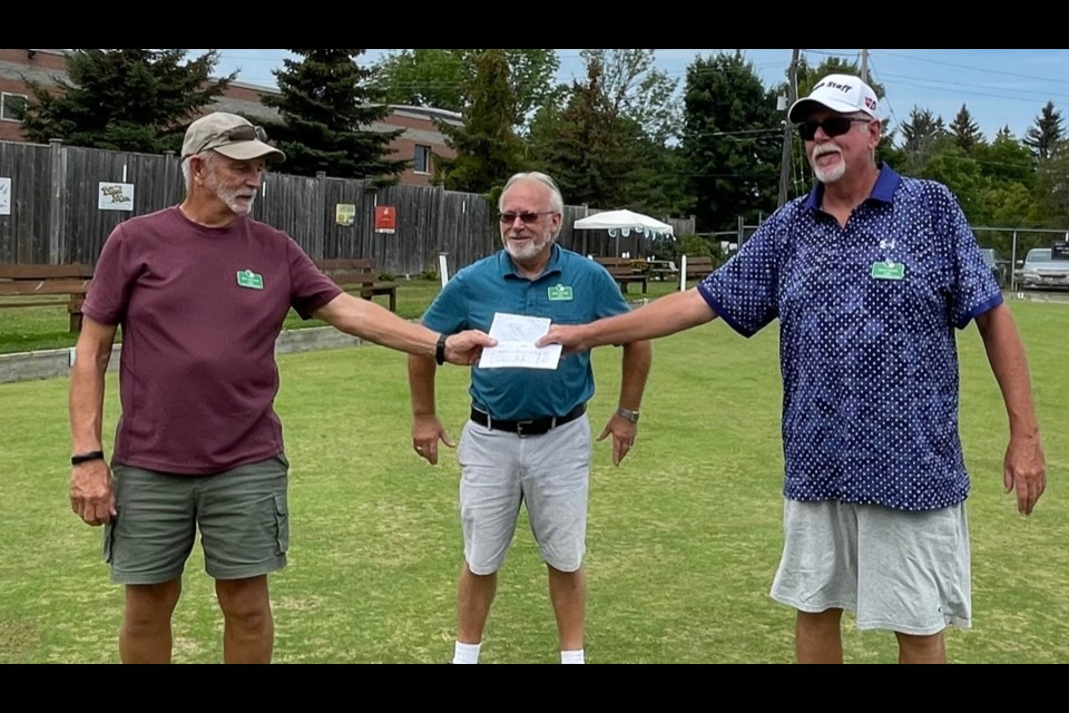 First Place at this week's fun tournament at the Orillia Lawn Bowling Club went to Mike Richard and Brian Minns, who are shown with drawmaster Rick Swinton.