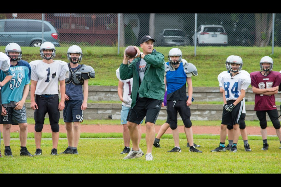 Nathan Box works on positioning with his players during a recent practice. He is entering his 17th year of coaching football at what is now known as Orillia Secondary School. Tyler Evans/OrilliaMatters