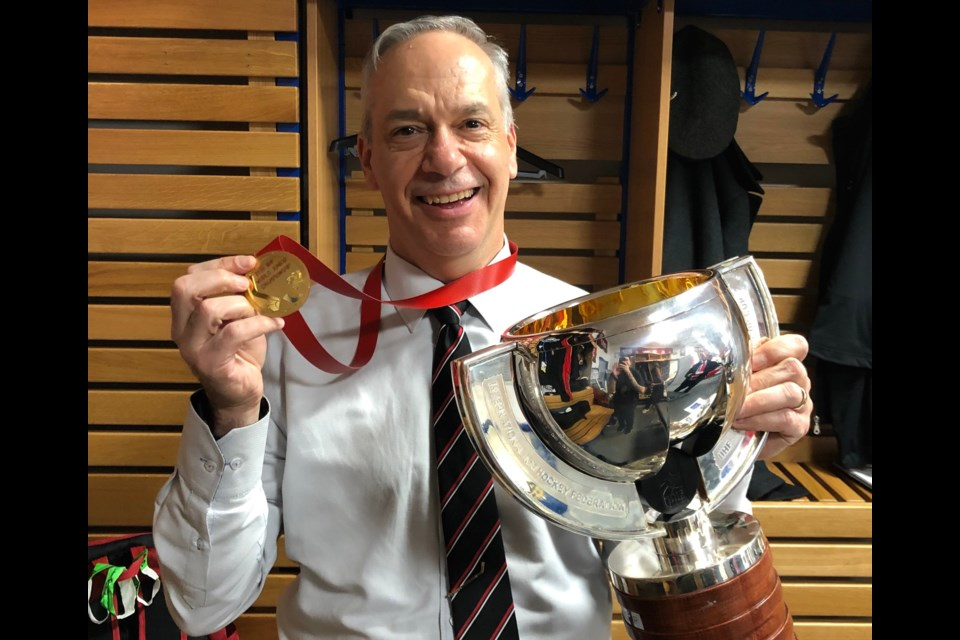 Orillian and Team Canada physician Ed Berdusco poses with his gold medal and the IIHF World Junior Championship Trophy after helping Canada get their star players back on the ice in time for their pivotal games. Contributed photo