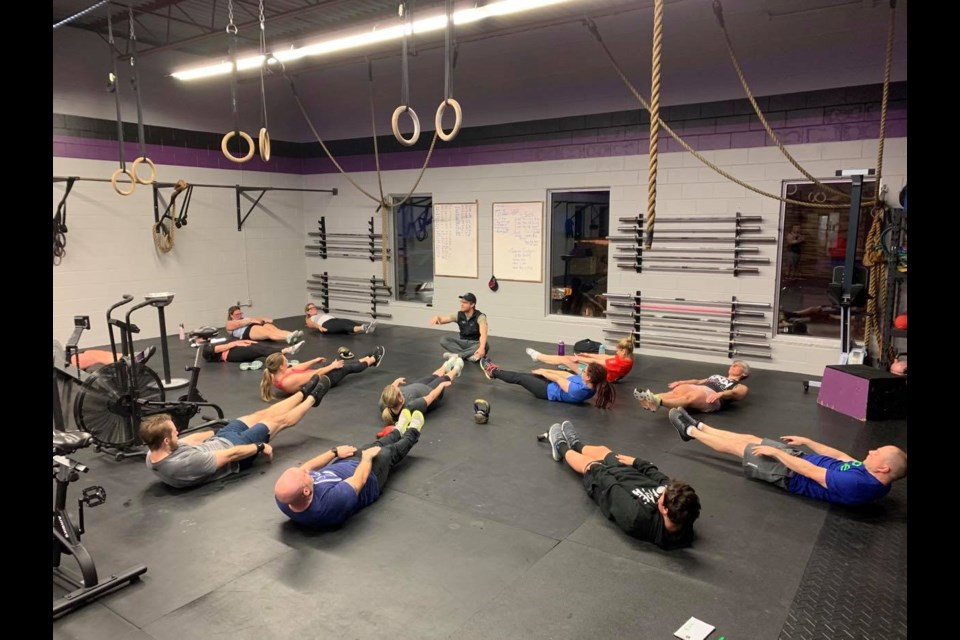 Certified CrossFit level 3 trainer Matt Spencer leads a workout for members at his locally-owned training facility. Contributed photo