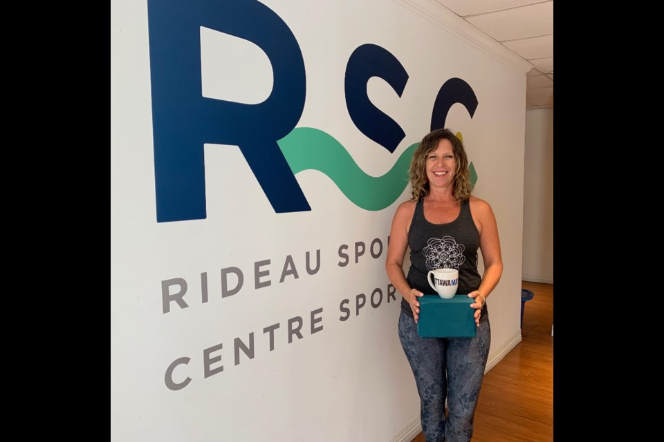 Nicki Bridgland, CEO of Rideau Sports Centre, poses with an OttawaMatters.com mug. (Andrew Pinsent/OttawaMatters.com)