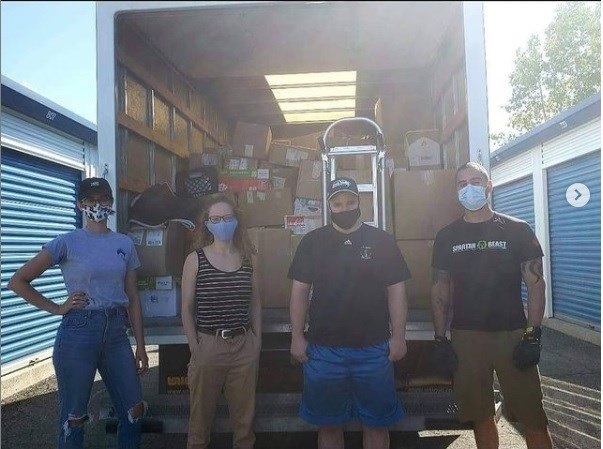 Kyle Huisman and other volunteers during a move with Shelter Movers Ottawa