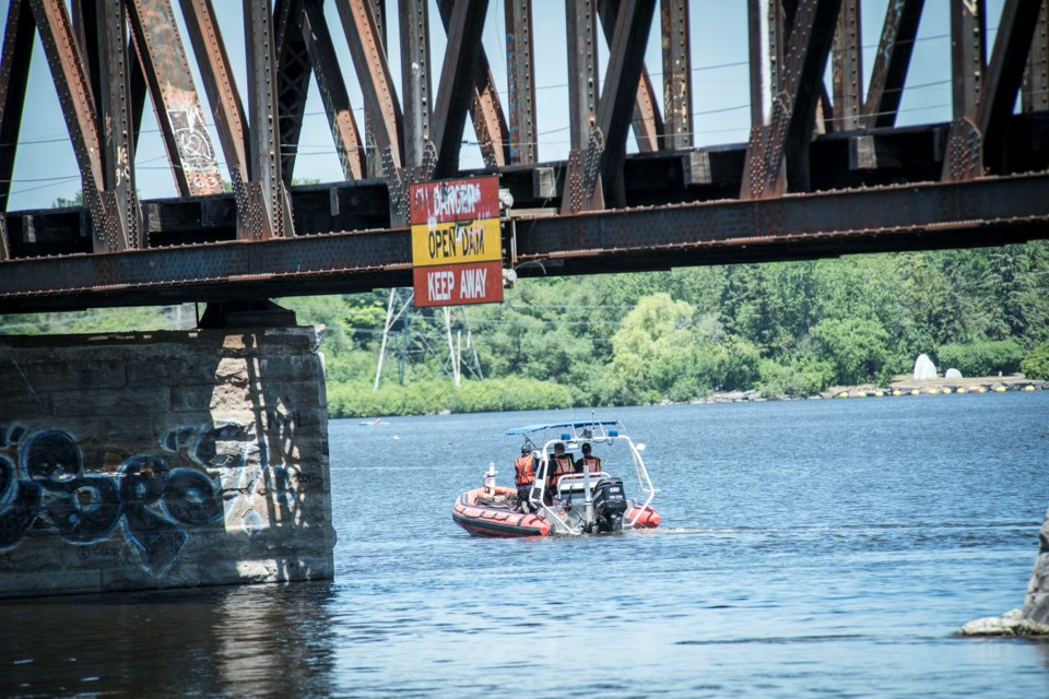 Police search for a missing 14-year-old boy who jumped off of the Prince of Wales Bridge on the evening of Friday, July 3. (Photo/Dani-Elle Dubé)