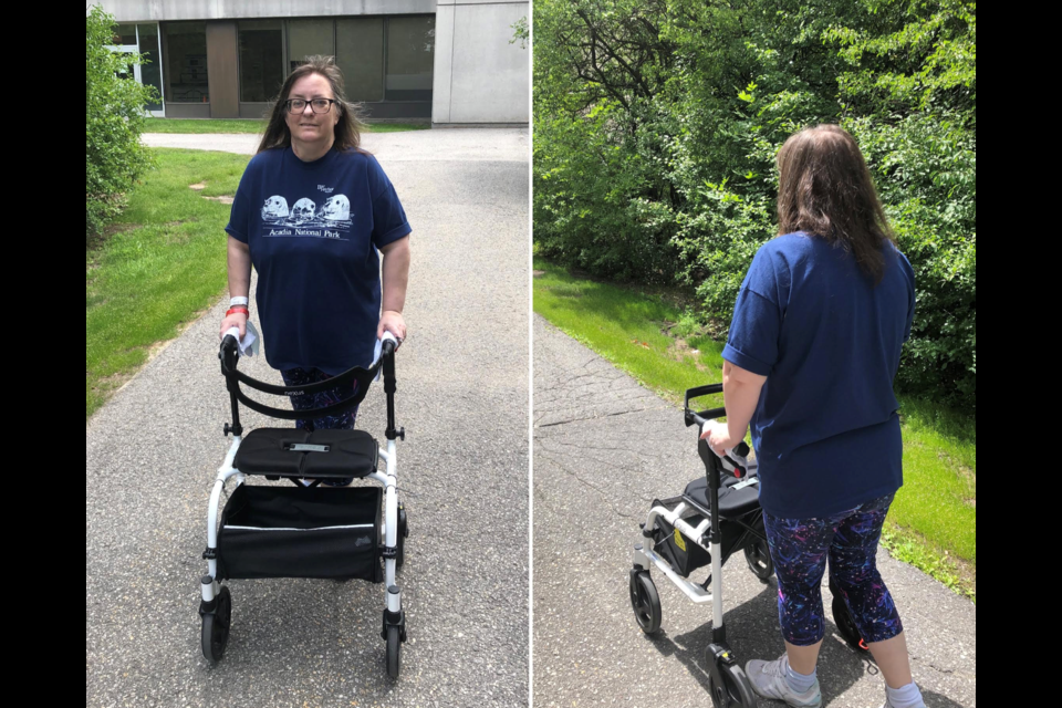 Angela Malik-Stenson practicing to walk with a four-wheel walker during COVID rehab. (Photo/Angela Malik-Stenson)