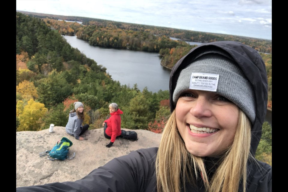 Victoria Walsh, with Davianna Grace and Anita Muller in the background, hike Rock Dunder, Frontenac, Ontario, in the fall 2018.