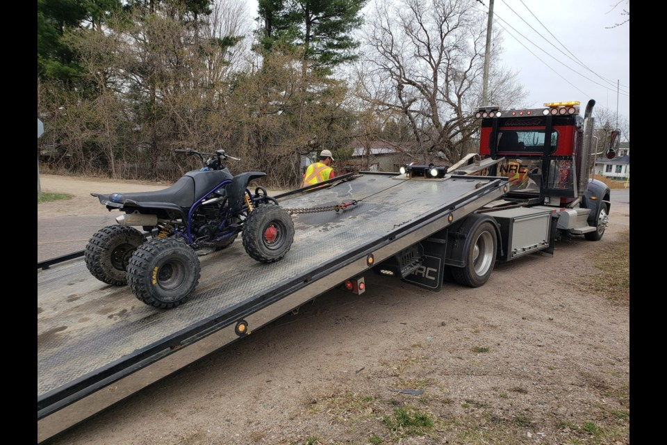 An ATV seized by OPP officers being towed in Pembroke, April 11, 2021. Photo by East Region OPP
