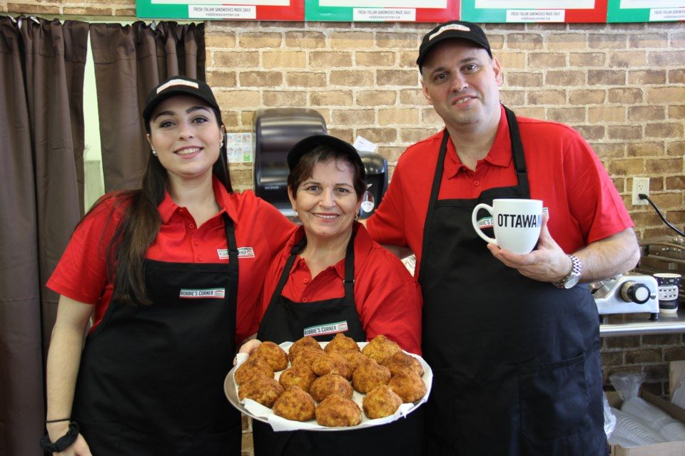 Selena Dialessandro, Valentina and Roberto opened Robbie's Corner December 1. Alex Robinson/OttawaMatters