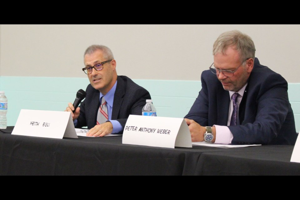 Incumbent councillor Keith Egli (left) was criticized during a debate on Sept. 30 for a lack of communication in the aftermath of last week's tornados in Dunrobin and Gatineau.