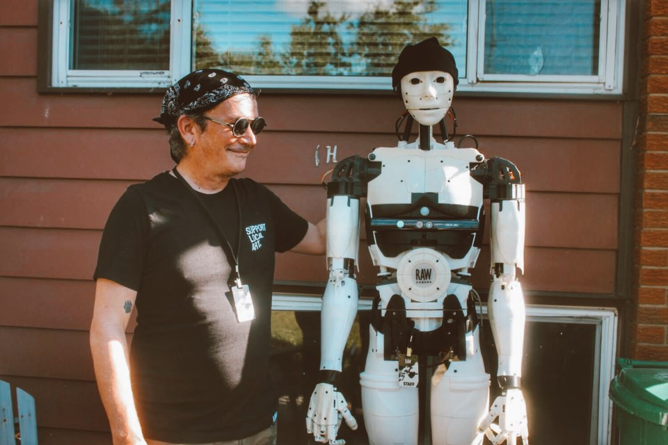 David Pattee shares a laugh with his creation, a robot known as RAW.b. Hollie Grace James photo