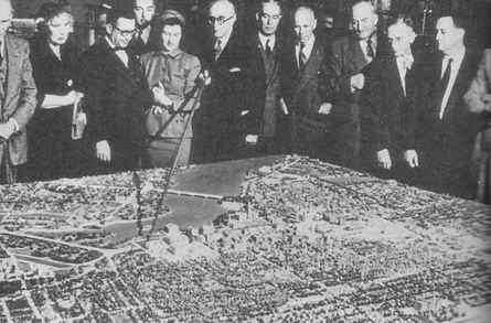 Jacques Gréber shows off the model of his plan for the National Capital to Members of Parliament, 30 April, 1949