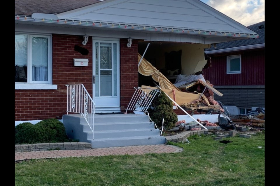 Damage to a home struck by a vehicle in Elmvale Acres, April 14, 2021. Alex Goudge/ CityNews