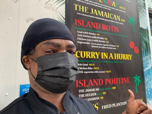 Chef Julian Goodluck at his food truck The Caribbean Cruiser. Photo/ Denis Armstrong