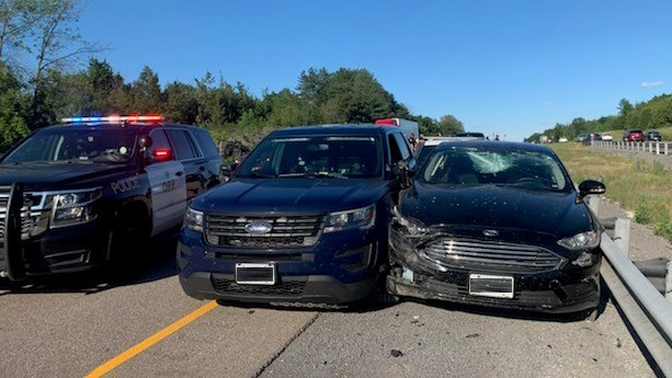 OPP cruisers box in a vehicle on the side of Highway 401, west of Kingston, July 4, 2021. Photo/ OPP