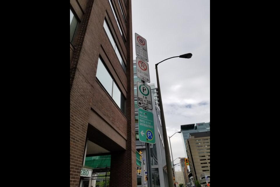 A parking sign in downtown Ottawa. (June 10, 2019/Jenn Pritchard)