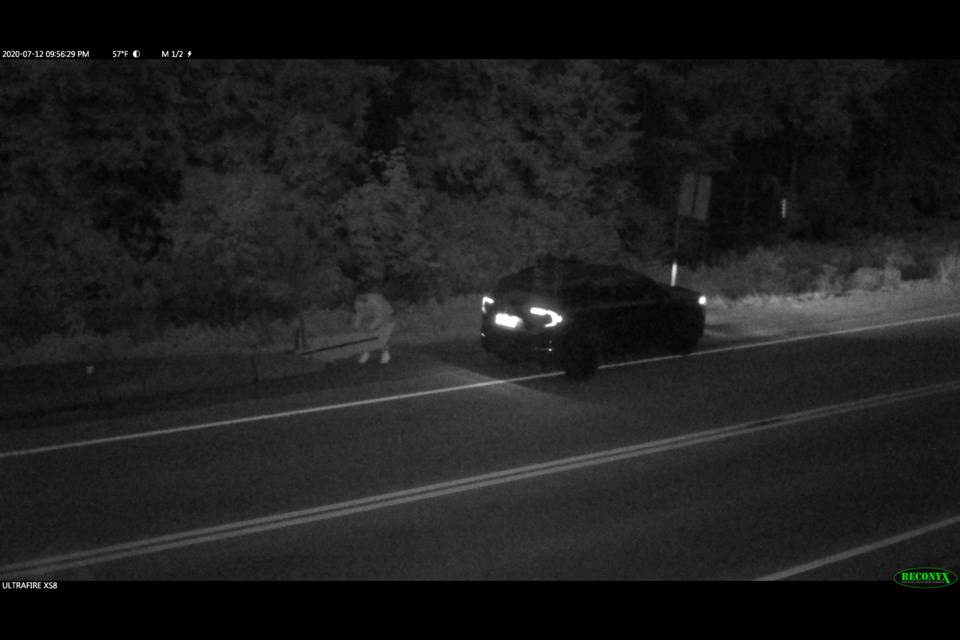A man captured last month on police surveillance footage near Pemberton who allegedly stole a plastic cutout that the local RCMP uses to deter speeders.  IMAGE COURTESY OF THE RCMP