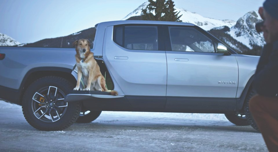 o-outsider 28.17 photo submitted by Rivian-r1t-gear-tunnel-dog-snow