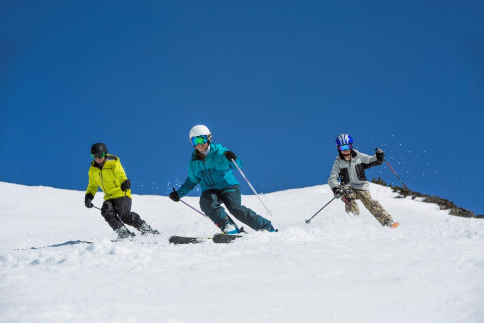 Whistler blackcomb ski instructor leads group on a sunny day