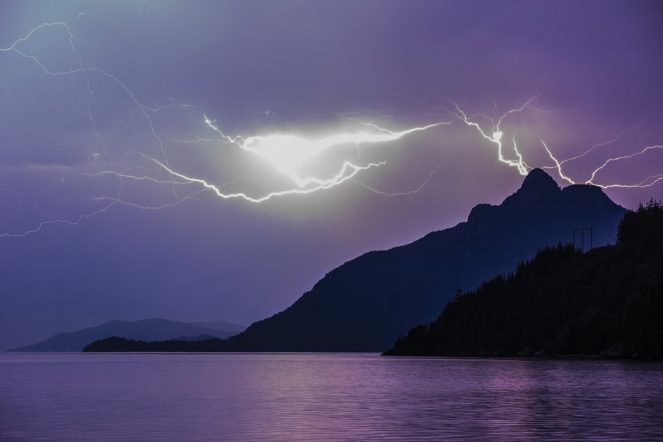 LIGHTNING ROUND Sea to Sky photographer Rich Duncan captured this image during a weekend lightning storm from the west side of Howe Sound. Photo by Rich Duncan.