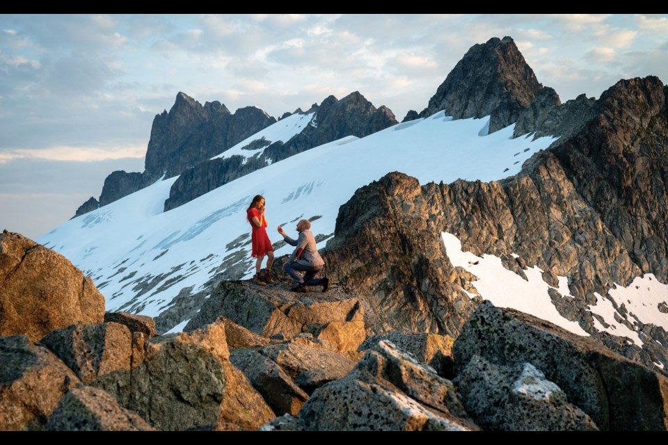 I DO Whistler photographer Mike Crane proposes to Whistler artist Jenna Jones in the Tantalus Range. And yes, Jenna said yes! Photo submitted by Mike Crane / @mikecranephotography