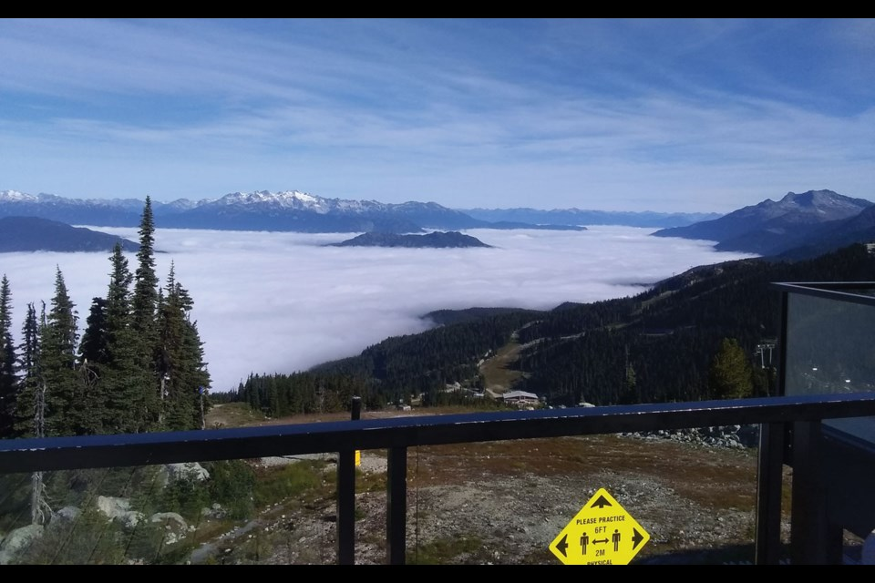 ABOVE THE CLOUDS Another beautiful day in Whistler—so long as you were above the cloud cover, as seen from Christine's. Photo by Ty Watts