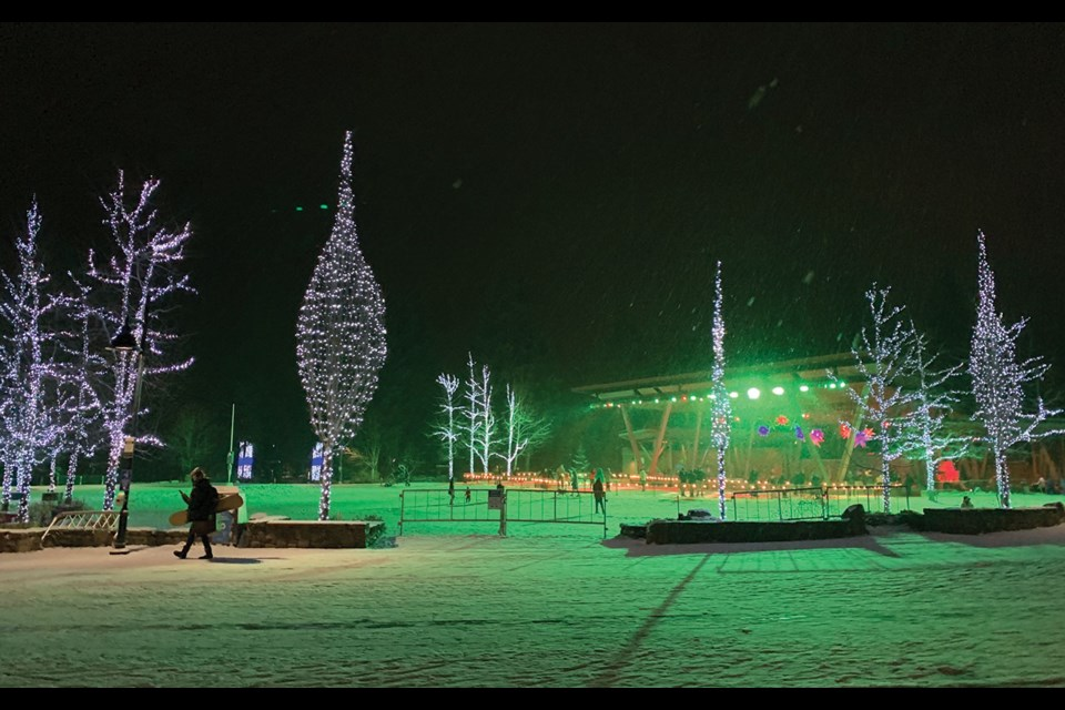 IT'S LIT Whistler's Olympic Plaza is aglow with Christmas lights this holiday season, while the ice rink is open to skaters.  Photo by Megan Lalonde