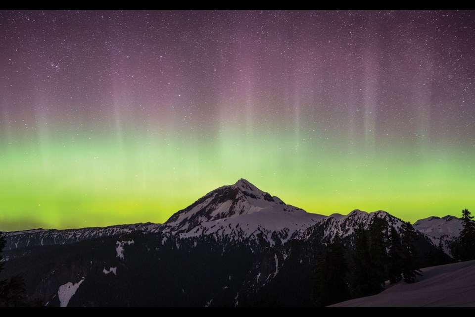 """SKY SCENES The aurora borealis came out to play in Whistler and the Sea to Sky this weekend, measuring in as a Kp 6 or """"Moderate Storm"""" This photo was snapped early on Saturday, April 17, from Round Mountain in Squamish, with Atwell Peak visible in the distance."""