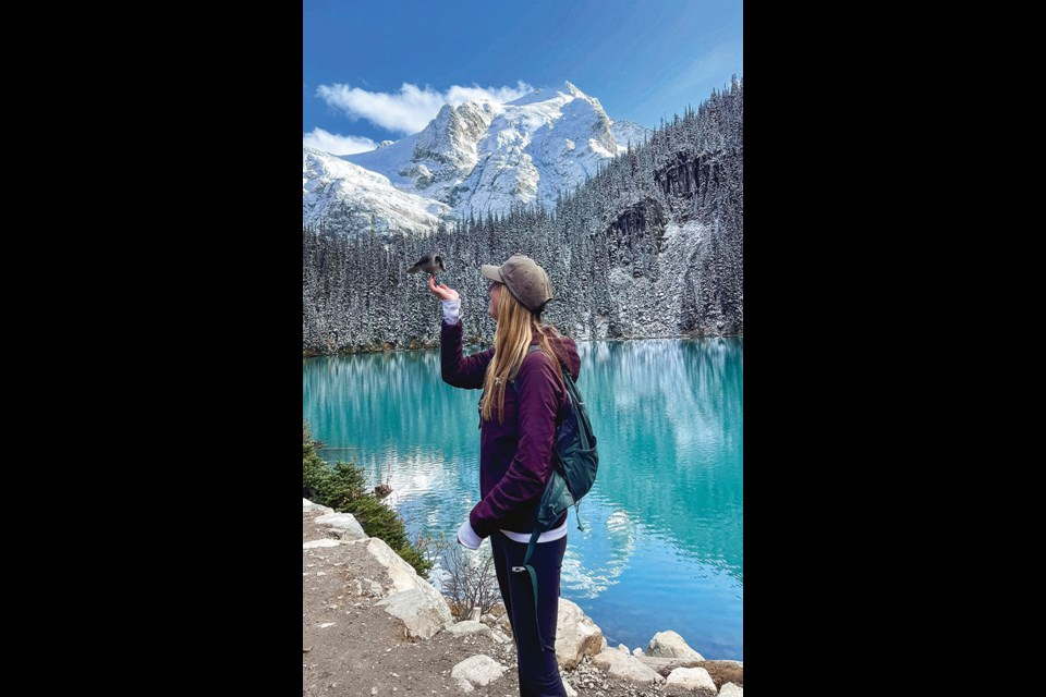 BIRD'S EYE VIEW Jesslyn Gates chats with a Whisky Jack during an unseasonably sunny trip to Joffre Lakes Provincial Park on Thursday, Oct.7.