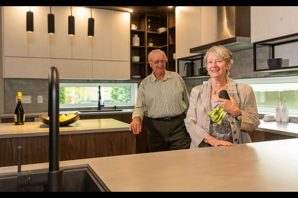 Fritz and Heidi Kym tour their PNE Prize home. Photo by Allen Lau Photography