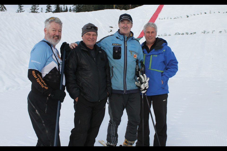 LOCAL LEGEND John Heilig (right) was an advocate for ski jumping and Nordic combined in Canada and across the world. He passed away last week in China while helping to prepare the venue for the 2022 Winter Games. Heilig is shown here at Whistler Olympic Park with Jim Woolsey, Andreas Andresen and Tom Thompson in 2015.