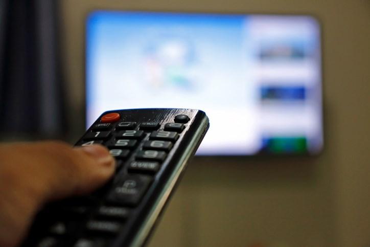 watching tv news stock photo