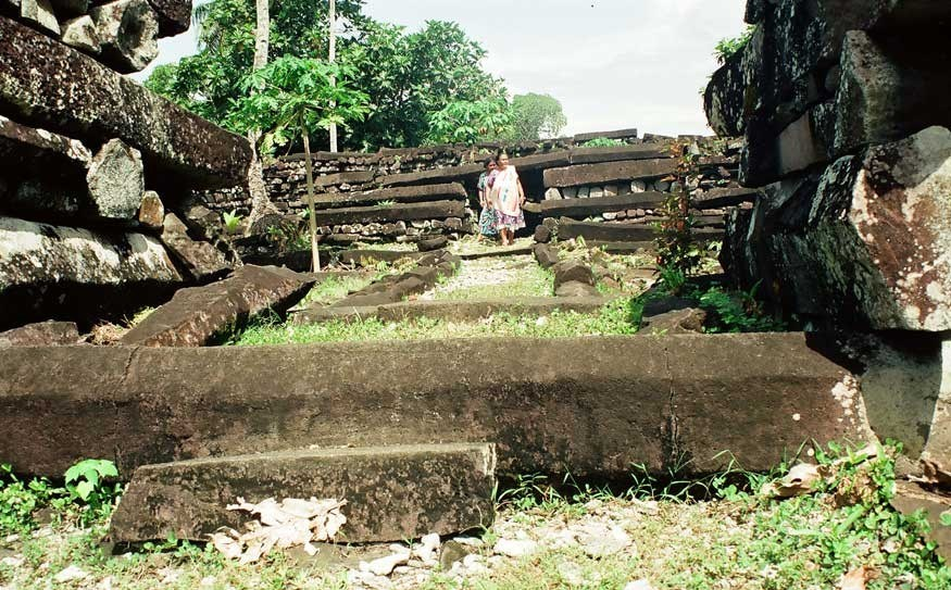 Walkers explore the ruins of Nan Madol, built on basalt columns for the dynasty that ruled the island until it was overthrown in the 16th century. PHOTO CREDIT Mitchell Smyth/Meridian Writers' Group