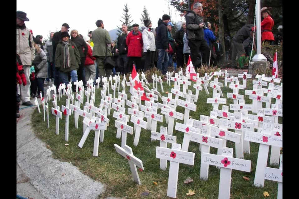 COMMEMORATIVE CROSSES Whistler businesses donated materials and young Whistler residents helped Whistler firefighters create crosses and place names of fallen soldiers on the crosses for Remembrance Day. Photo by John French