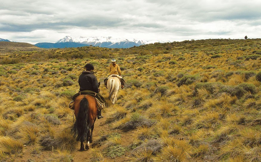 Trotting off-trail with the Andes on the horizon. Photo by Dave Clendenan