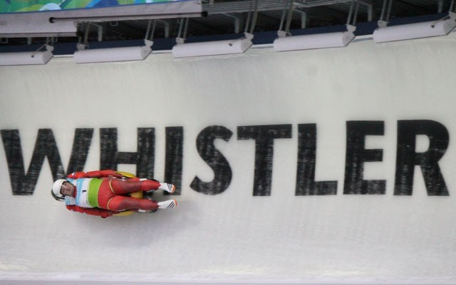 The Russian duo of Evgeny Evdokimov and Alexey Groshev compete in the junior doubles event at Whistler Sliding Centre on Thursday. Photo by Dan Falloon
