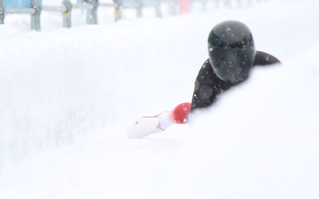 Canadian skeleton racer Jaclyn LaBerge emerges from the snow as she completes her second run in Intercontinental Cup action at Whistler Sliding Centre on Saturday. LaBerge won gold. Photo by Dan Falloon