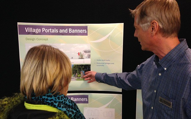 FINDING THE WAY Director of planning Mike Kirkegaard explains some details of the Village Portals and Banners project at an open house on Jan. 21. Photo by Braden Dupuis