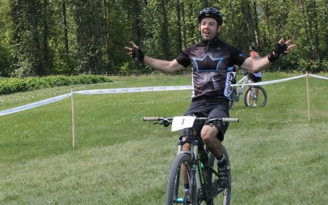 Ricky Federau celebrates after winning the NIMBY Fifty on May 30. Photo by Dan Falloon