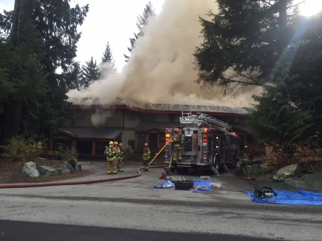 BATTLING BLAZE Firefighters work to control morning fire at 8100 Alpine Way, Alpine House. PHOTO BY ALISON TAYLOR