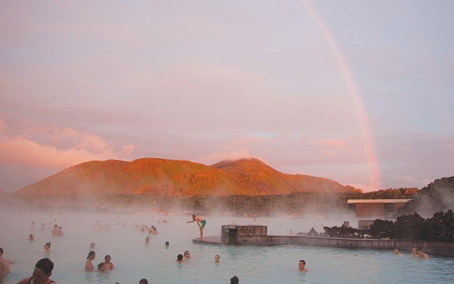 A striking Rainbow over the Blue Lagoon in one direction and a fiery sunset in the other. Photo by Lisa TE Sonne