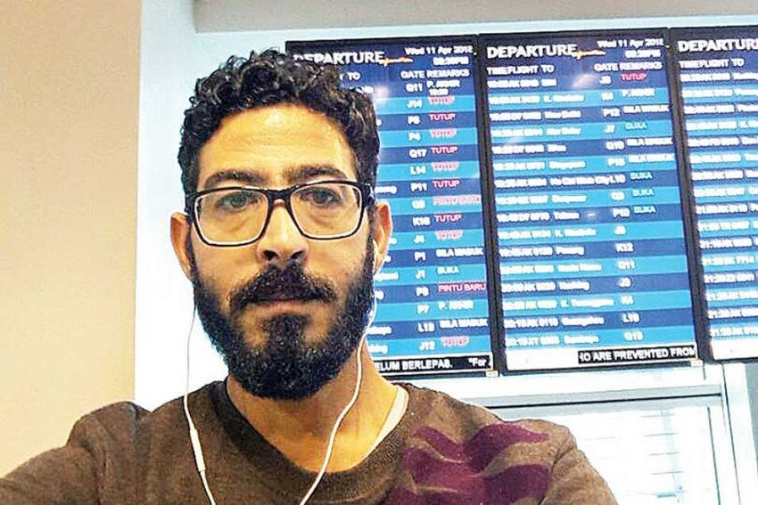 syrian-asylum-seeker-hassan-al-kontar-is-pictured-at-a-kuala