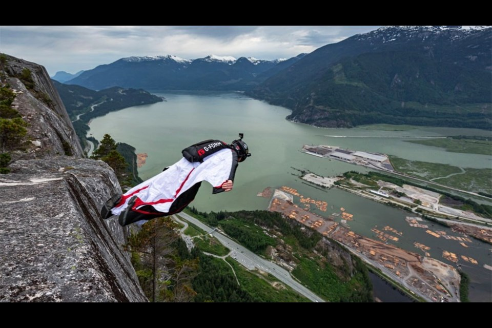 Jamie Flynn steps off the Stawamus Chief. By 2016, he had base jumped 1,000 times. He has since stopped counting. Photo by James Frustak