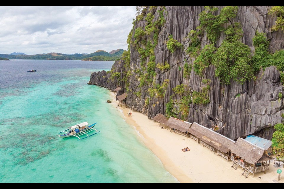 Aerial view of Banol Beach on paradise island, Coron, Palawan, Philippines - tropical travel destination. Photo by Simon Dannhauer / gettyimages.ca