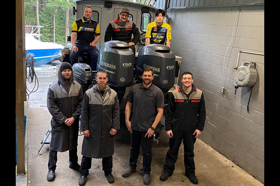 OUTDOOR AMBASSADORS: Two Wheel Tech owner Derek Jantz [front, second from right] and his team of mechanics and parts people are passionate about outdoor powersports. They provide service, maintenance, parts and accessories for Powell River's outdoor motorsport community.