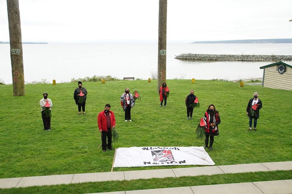[From left] Jen Ramsay, Powell River and Region Transition House Society; Losa Luaifoa, executive councillor Tla'amin Nation; Randolph Timothy Jr., coordinator of the Family Tree program; Doreen Hopkins, Tla'amin elders coordinator; Angela George; Amy Timothy; co-organizer Cyndi Pallen (Chenney); and Annette Mennitti (transition house society) prepared for the missing and murdered indigenous women walk at Willingdon Beach, with cedar boughs and red dresses to mark the trails.